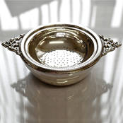 Tea Strainer and Bowl with Double Handle from L J Millington Silversmiths Birmingham West Midlands UK